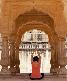 Amber Fort woman performing yoga, rear view - Doctor Mosaraf Ali