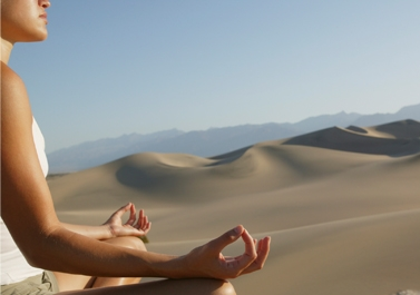 Woman meditating in desert - Doctor Mosaraf Ali